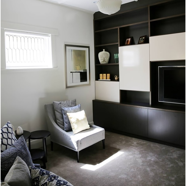 Custom bookshelf and entertainment cabinet - wall to wall and floor to ceiling installation